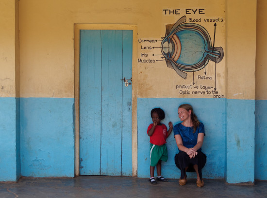 LisaHamm with a child at a vision screening day