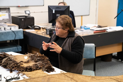 Mrs Ranui Ngarimu examining Te Ra at the British Museum London. Photo by Adam Rowley