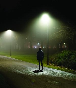 Man and street lights