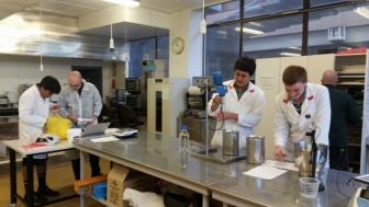 2017 Team PNBHS  at the Massey University lab at Massey Uni with their mentor