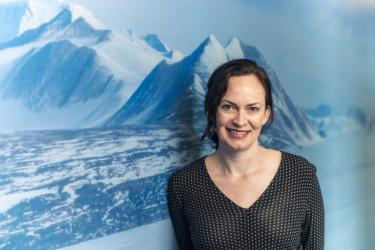 Rebecca in front of Antarctica map 768x513